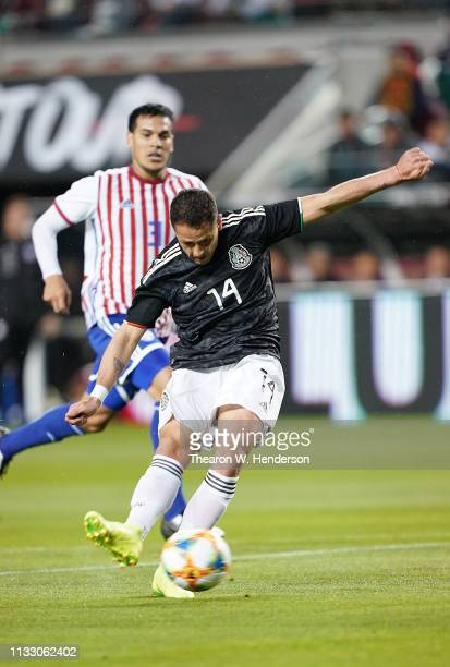 Javier Hernandez of the Mexico National team shoots and scores against Paraguay during the first half of their soccer game at Levi's Stadium on March...