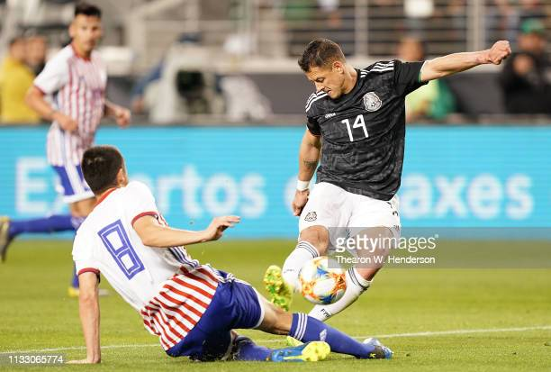 Javier Hernandez of the Mexico National team shoots on goal getting his shot past Rodrigo Rojas of Paraguay during the second half of their soccer...