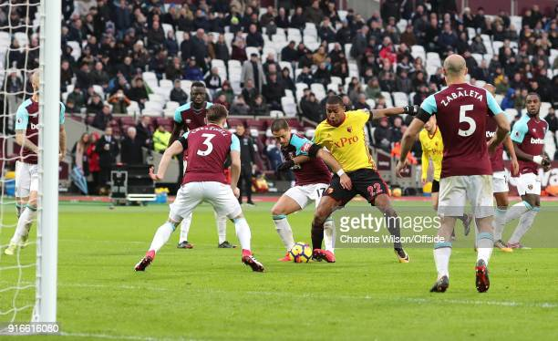 Javier Hernandez of West Ham and Marvin Zeegelaar of Watford battle for the ball in the box during the Premier League match between West Ham United...