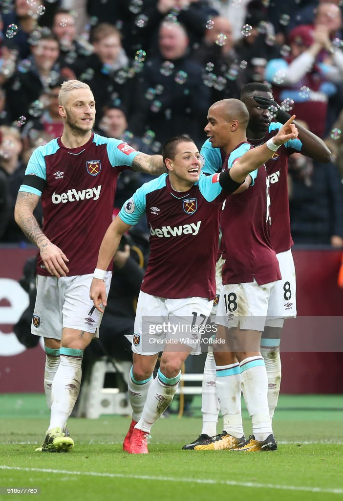 Javier (Chicharito) Hernandez of West Ham celebrates scoring their 1st goal with Marko Arnautovic of West Ham, Joao Mario of West Ham and Cheikhou Kouyate of West Ham during the Premier League match between West Ham United and Watford at London Stadium on February 10, 2018 in London, England.