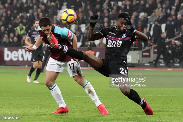 Javier Hernandez of West Ham in action with Timothy FosuMensah of Crystal Palace during the Premier League match between West Ham United and Crystal...