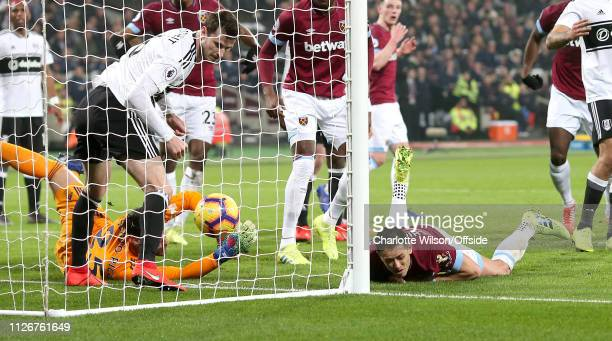 Javier Hernandez of West Ham scores their first goal during the Premier League match between West Ham United and Fulham FC at London Stadium on...