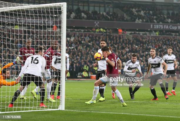 Javier Hernandez of West Ham scores their first goal with his arm during the Premier League match between West Ham United and Fulham FC at London...