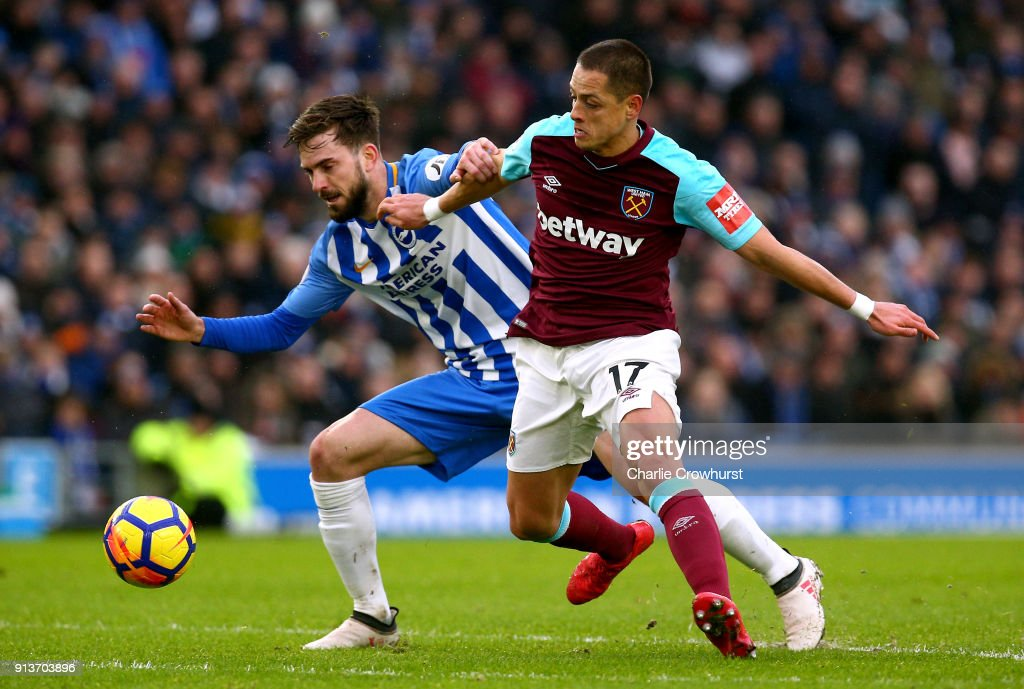 Javier Hernandez of West Ham United and Davy Propper of Brighton and Hove Albion battle for the ball during the Premier League match between Brighton and Hove Albion and West Ham United at Amex Stadium on February 3, 2018 in Brighton, England.