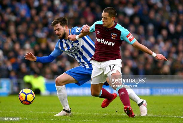 Javier Hernandez of West Ham United and Davy Propper of Brighton and Hove Albion battle for the ball during the Premier League match between Brighton...