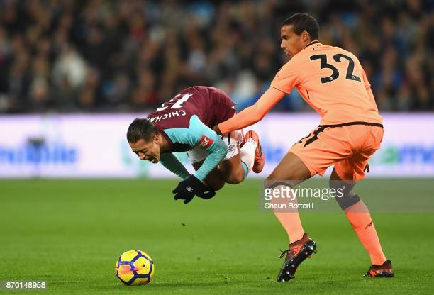 Javier Hernandez of West Ham United and Joel Matip of Liverpool in action during the Premier League match between West Ham United and Liverpool at...