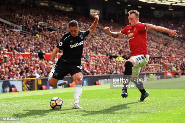 Javier Hernandez of West Ham United attempts to cross as Phil Jones of Manchester United attempts to block during the Premier League match between...