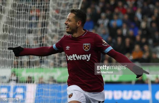 Javier Hernandez of West Ham United celebrates after he scores his sides opening goal during the Premier League match between Newcastle United and...