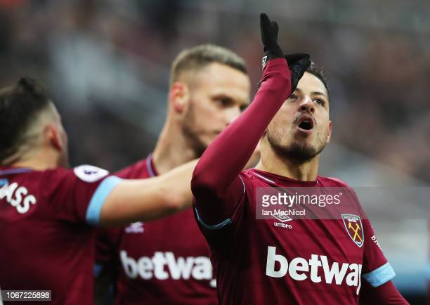 Javier Hernandez of West Ham United celebrates after he scores his sides first goal during the Premier League match between Newcastle United and West...