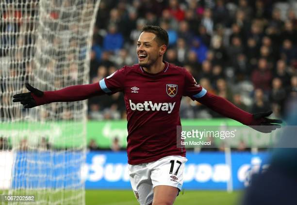 Javier Hernandez of West Ham United celebrates after scoring his team's first goal during the Premier League match between Newcastle United and West...