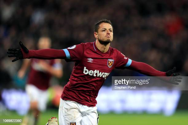 Javier Hernandez of West Ham United celebrates after scoring his team's third goal during the Premier League match between West Ham United and...