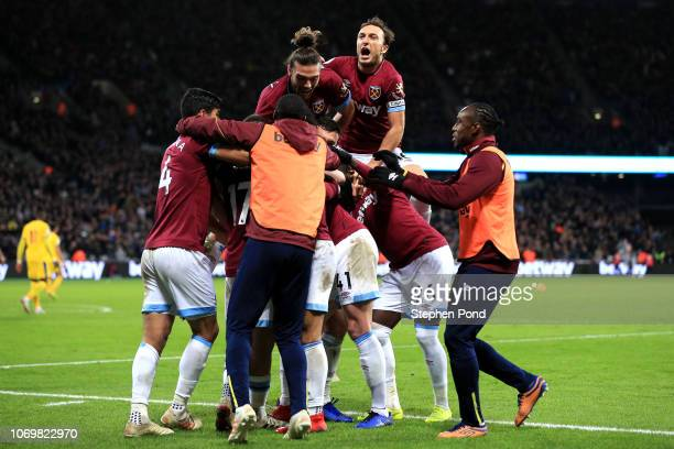 Javier Hernandez of West Ham United celebrates after scoring his team's second goal with his team mates during the Premier League match between West...