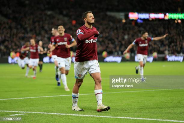 Javier Hernandez of West Ham United celebrates after scoring his team's second goal during the Premier League match between West Ham United and...