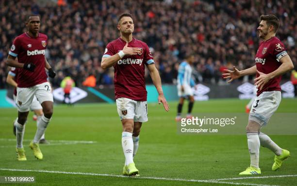Javier Hernandez of West Ham United celebrates after scoring his team's third goal with Aaron Cresswell of West Ham United during the Premier League...