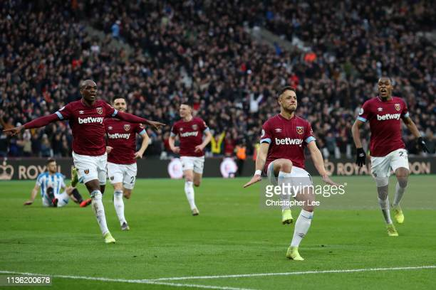 Javier Hernandez of West Ham United celebrates after scoring his team's fourth goal during the Premier League match between West Ham United and...