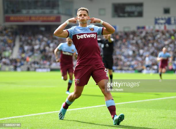 Javier Hernandez of West Ham United celebrates after scoring his team's first goal during the Premier League match between Brighton Hove Albion and...