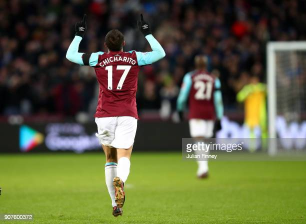 Javier Hernandez of West Ham United celebrates after scoring his sids first goal during the Premier League match between West Ham United and AFC...