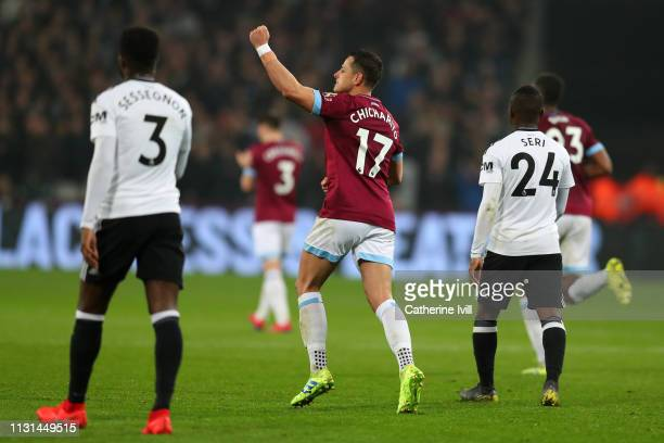 Javier Hernandez of West Ham United celebrates scoring his side's first goal during the Premier League match between West Ham United and Fulham FC at...