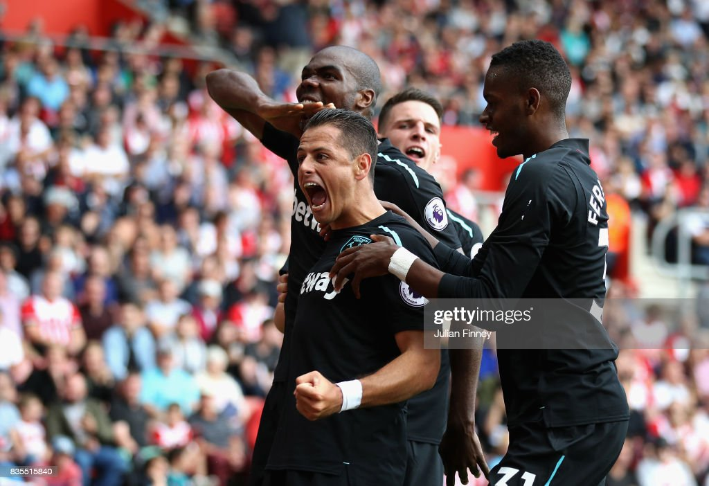 Javier Hernandez of West Ham United celebrates scoring his sides second goal with his West Ham United team mates during the Premier League match between Southampton and West Ham United at St Mary's Stadium on August 19, 2017 in Southampton, England.