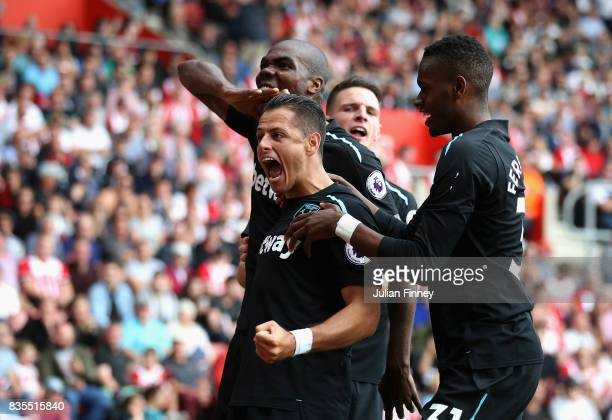Javier Hernandez of West Ham United celebrates scoring his sides second goal with his West Ham United team mates during the Premier League match...