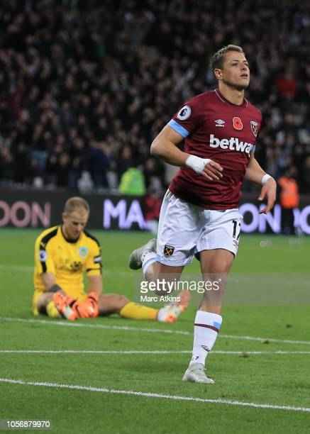 Javier Hernandez of West Ham United celebrates scoring their 4th goal as Joe Hart of Burnley looks on during the Premier League match between West...