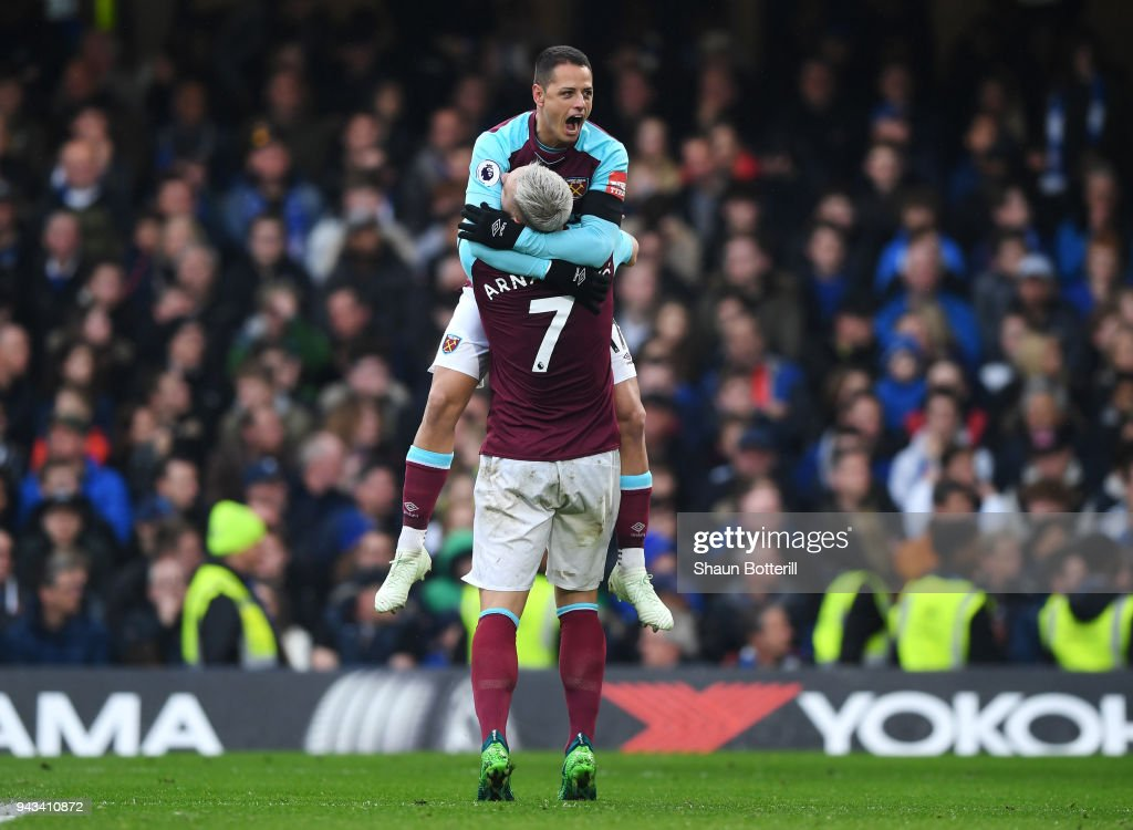 Javier Hernandez of West Ham United celebrates with team mate Marko Arnautovic of West Ham United after scoring his sides first goal during the Premier League match between Chelsea and West Ham United at Stamford Bridge on April 8, 2018 in London, England.