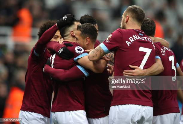 Javier Hernandez of West Ham United celebrates with teammates after scoring his team's first goal during the Premier League match between Newcastle...