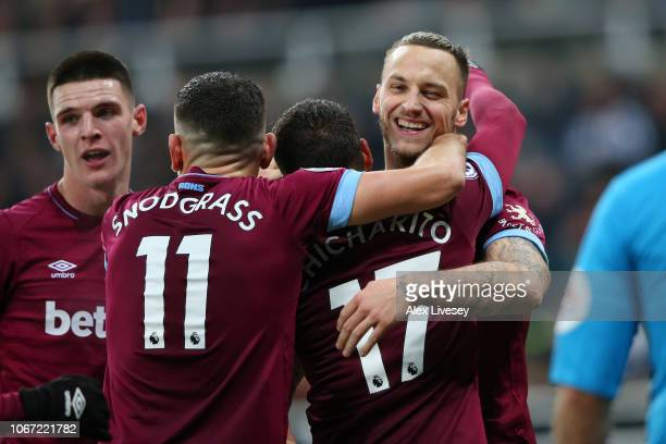 Javier Hernandez of West Ham United celebrates with teammates after scoring his team's second goal during the Premier League match between Newcastle...