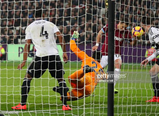 Javier Hernandez of West Ham United scores his side's first goal past Sergio Rico of Fulham during the Premier League match between West Ham United...