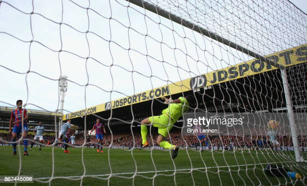 Javier Hernandez of West Ham United scores his sides first goal past Joe Hart of West Ham United during the Premier League match between Crystal...