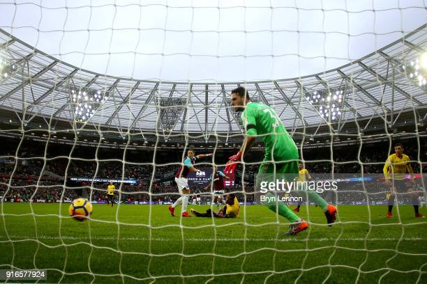 Javier Hernandez of West Ham United scores his sides first goal during the Premier League match between West Ham United and Watford at London Stadium...