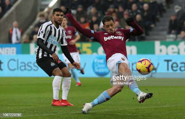 Javier Hernandez of West Ham United scores his sides opening goal during the Premier League match between Newcastle United and West Ham United at St...