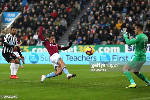 Javier Hernandez of West Ham United scores his team's first goal during the Premier League match between Newcastle United and West Ham United at St...