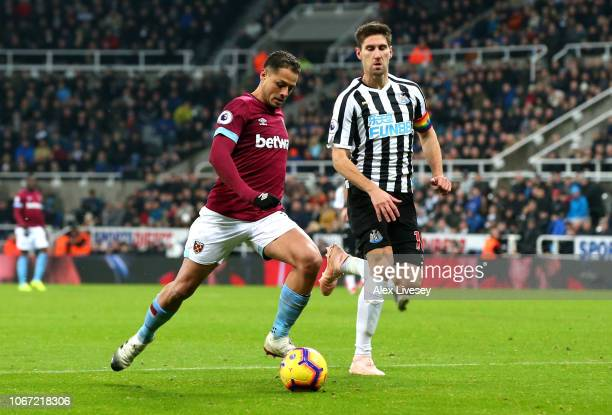 Javier Hernandez of West Ham United scores his team's second goal during the Premier League match between Newcastle United and West Ham United at St...