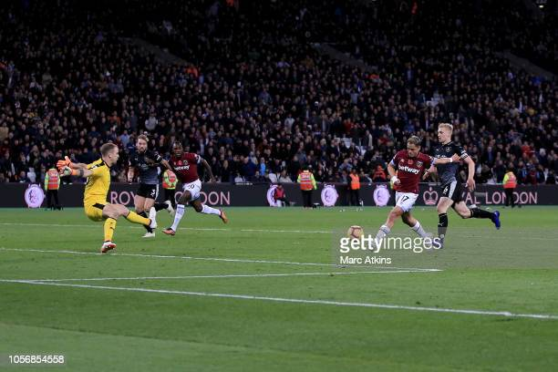 Javier Hernandez of West Ham United scores his team's third goal past Joe Hart of Burnley during the Premier League match between West Ham United and...