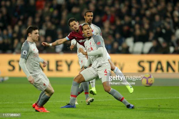 Javier Hernandez of West Ham United shoots past Virgil van Dijk of Liverpool during the Premier League match between West Ham United and Liverpool FC...