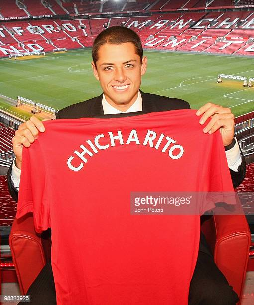 Javier Hernandez poses with a Manchester United shirt with his nickname Chicharito on the back at Old Trafford on April 8 2010 in Manchester England...