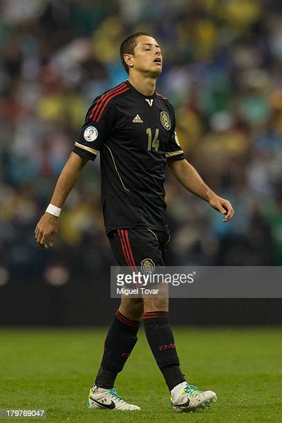 Javier Hernandez reacts after losing against Honduras during a match between Mexico and Honduras as part of the 15th round of the South American...