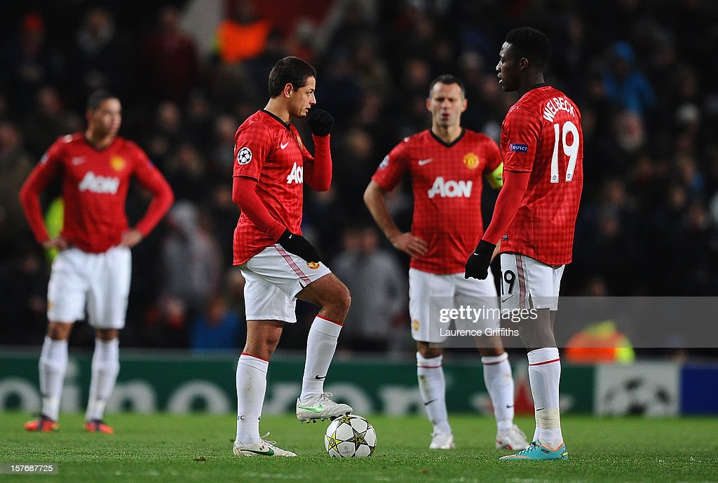 Javier Hernandez, Ryan Giggs and Danny Welbeck of Manchester United prepare to kick off after conceding the first goal during the UEFA Champions League Group H match between Manchester United and CFR 1907 Cluj at Old Trafford on December 5, 2012 in Manchester, England.