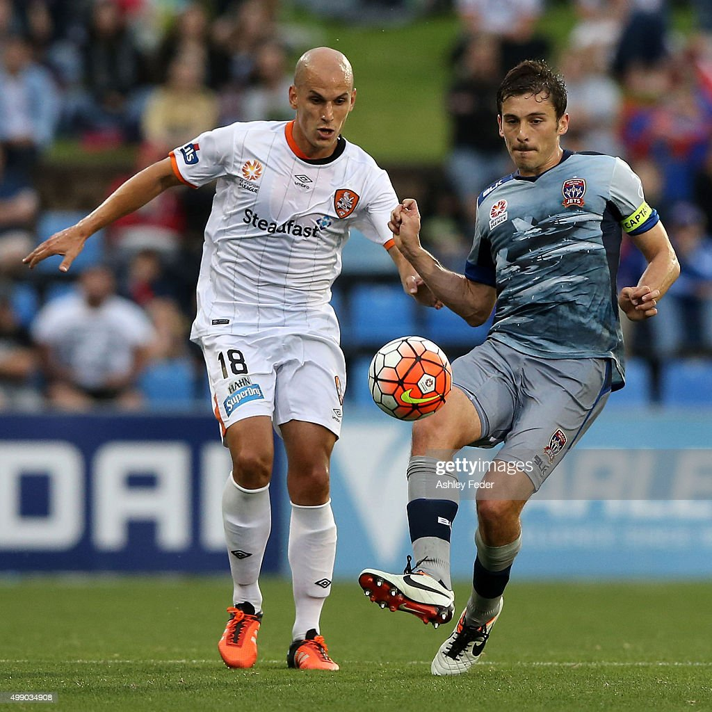 Javier Hervas of the Roar contests the ball against Mateo Poljak of the Jets during the round eight A-League match between the Newcastle Jets and Brisbane Roar at Hunter Stadium on November 28, 2015 in Newcastle, Australia.