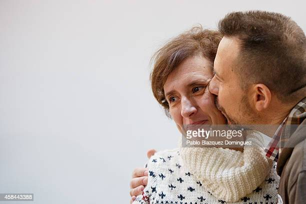 Javier Limon kisses his wife Spanish nurse Teresa Romero during a meeting with the press before she leaves Carlos III Hospital after being discharged...