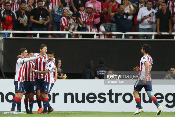 Javier Lopez of Chivas celebrates with his teammates after scoring the second goal of his team during the quarterfinals second leg match between...