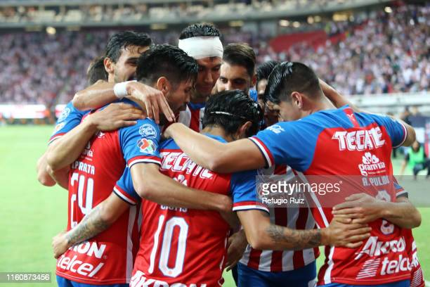 Javier Lopez of Chivas celebrates with teammates after scoring his team's first goal during the 4th round match between Chivas and Atletico San Luis...