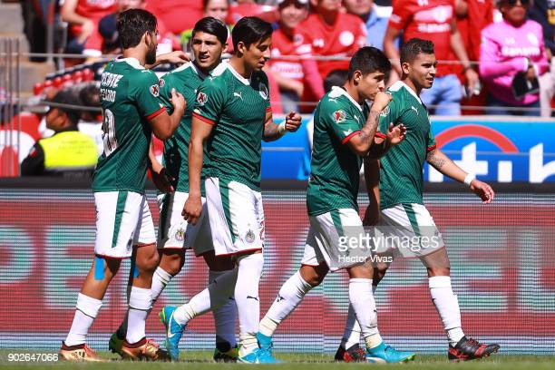 Javier Lopez of Chivas celebrates with teammates after scoring the first goal of his team during the first round match between Toluca and Chivas as...