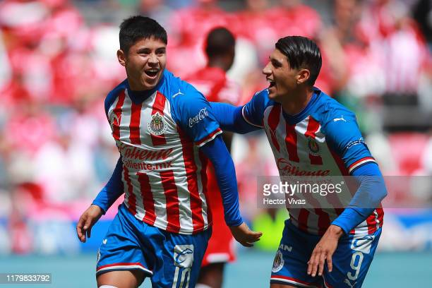 Javier Lopez of Chivas celebrates with teammates after the opening goal of his team during the 17th round match between Toluca and Chivas as part of...