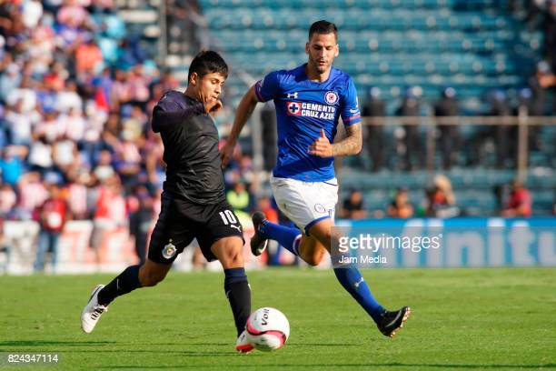 Javier Lopez of Chivas fights for the ball with Edgar Mendez of Cruz Azul during the 2nd round match between Cruz Azul and Chivas as part of the...