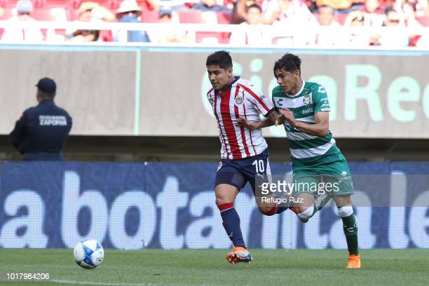 Javier Lopez of Chivas fights for the ball with Jose Abella of Santos during the fourth round match between Chivas and Santos Laguna as part of the...