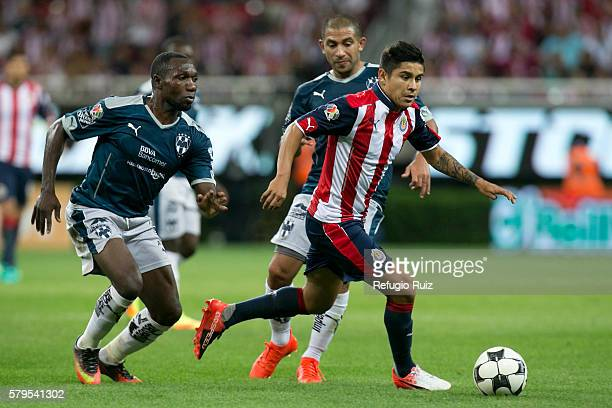 Javier Lopez of Chivas fights for the ball with Walter Ayovi of Monterrey during the 2nd round match between Chivas and Monterrey as part of the...