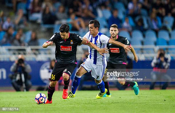 Javier Lopez of RCD Espanyol duels for the ball with Juanmi of Real Sociedad during the La Liga match between Real Sociedad de Futbol and RCD...