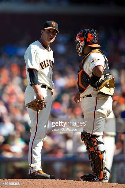 Javier Lopez of the San Francisco Giants talks to Hector Sanchez on the pitchers mound against the New York Mets during the ninth inning at ATT Park...